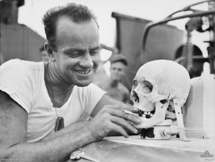 Lieutenant (junior grade) e. v. mcpherson, of columbus, ohio with a japanese skull which serves as a mascot aboard the united states navy motor torpedo boat 341